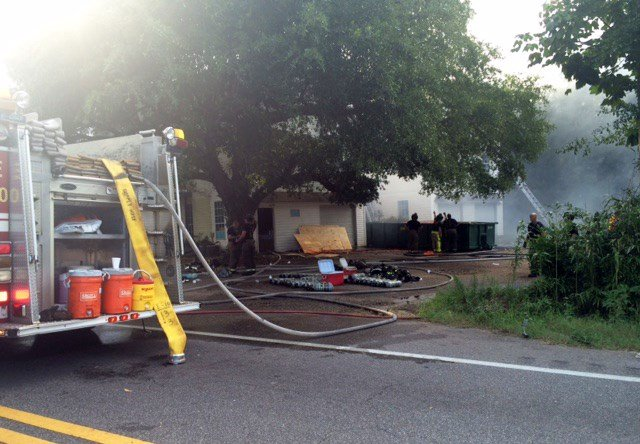 Firefighters work a fire on Howells Ferry Road at Cody Road Saturday, July 30, 2016, in Mobile, Ala. (Photo: Lee Peck, FOX10 News)