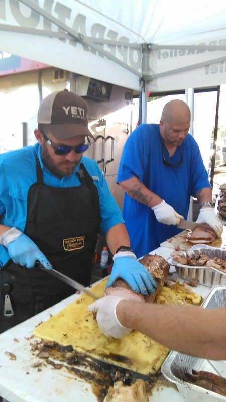Volunteers with Operation BBQ Relief prepare meals for those affected in Baton Rouge, LA (Photo: Edward Perdensen)