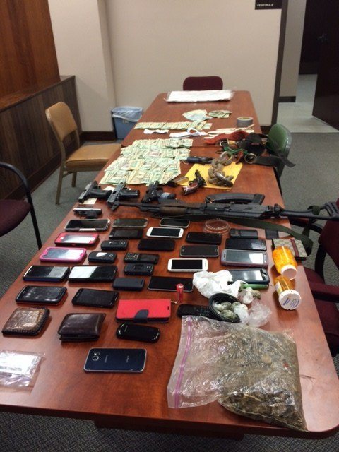 Thousands of dollars in cash, marijuana, prescription pills and six guns were confiscated.