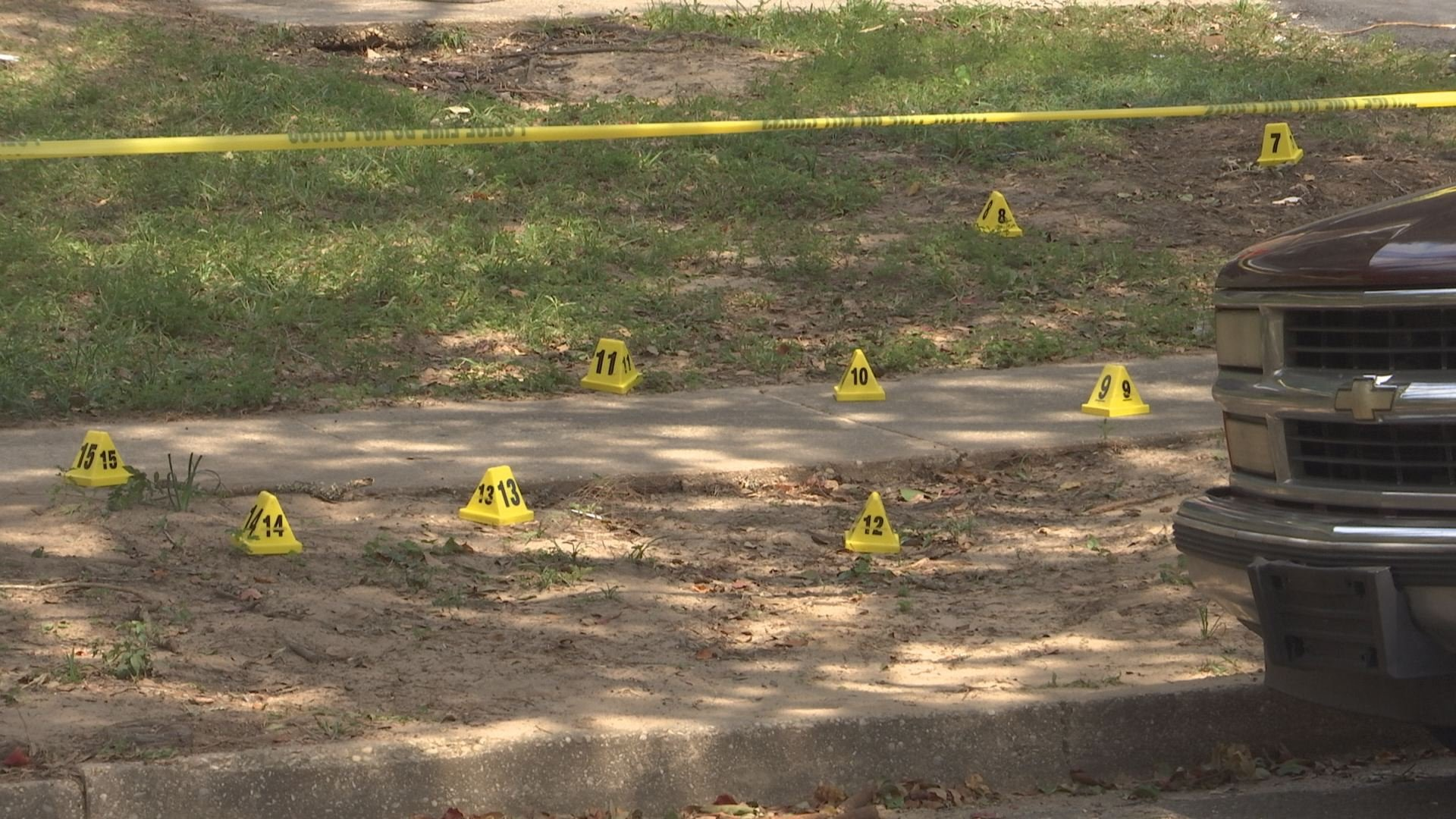 Shell casings were scattered around the front yard of a home on Wicker Way in Mobile after a drive-by shooting. (Credit: Daeshen Smith, WALA FOX10 News)