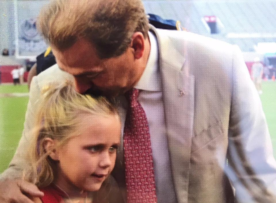 Aubreigh Nicholas of Semmes, 10, who has a rare and inoperable brain cancer known as DIPG, is kissed by Alabama Coach Nick Saban during a visit to Tuscaloosa Saturday, Sept. 30, 2017. (Photo courtesy @aubreighsarmy)