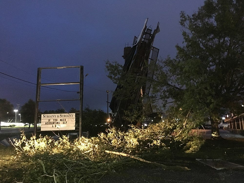 A large billboard was downed in west Mobile off Airport Boulevard. (FOX10 News)
