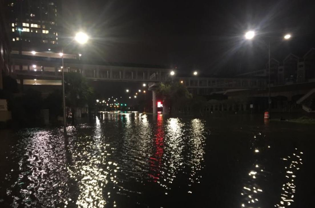 Water covers Water Street early Sunday morning in downtown Mobile. (Photo: Rodney Rocker, FOX10 News)