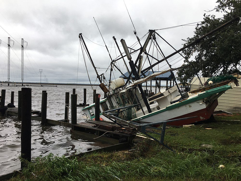A boat tied up in Moss Point, Miss., was damaged by Hurricane Nate. (Photo: Matt Barrentine, FOX10 News)