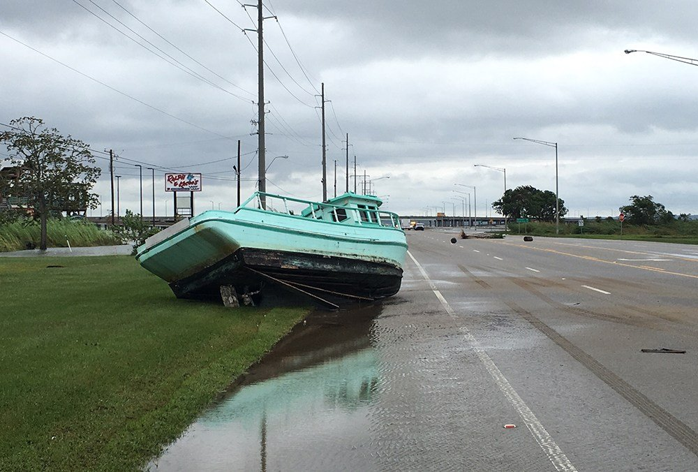 A boat that was on the Felix's Fish Camp property came to rest alongside the Causeway roadway as Nate moved through the region. (Photo: Hal Scheurich, FOX10 News)