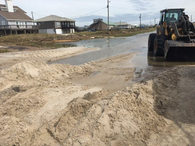 Crews work to clear sand from road surfaces on Dauphin Island after Hurricane Nate moves through the region. (Photo: Alexa Knowles, FOX10 News)