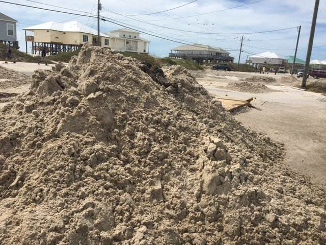 Sand is pile up on Dauphin Island. (Photo: Alexa Knowles, FOX10 News)