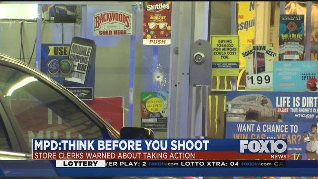 Clerk who fired at robbery suspect and hit innocent bystander could face charges. Source: FOX 10 News