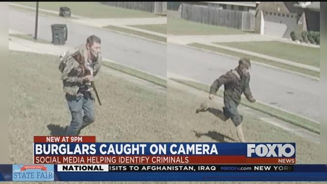 Suspects in Semmes burglary caught on camera. One seen carrying a rifle. Source: MCSO