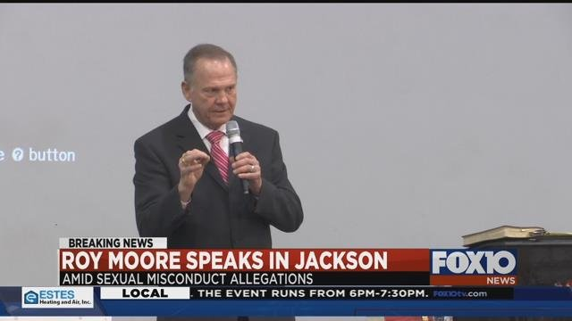 "AL U.S. Senate candidate Roy Moore speaks before the ""God Save America"" Revival Tuesday night in Jackson, AL. Source: Lee Peck, FOX 10 News"