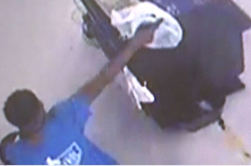 Surveillance image from shootout inside store (FOX10 News)