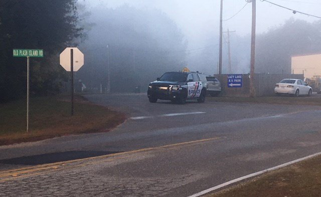 Gulf Shores Police search the area of Old Plash Island Road for a felony domestic violence suspect early Friday, Dec. 1, 2017. (Photo: Steve Alexander, FOX10 News)
