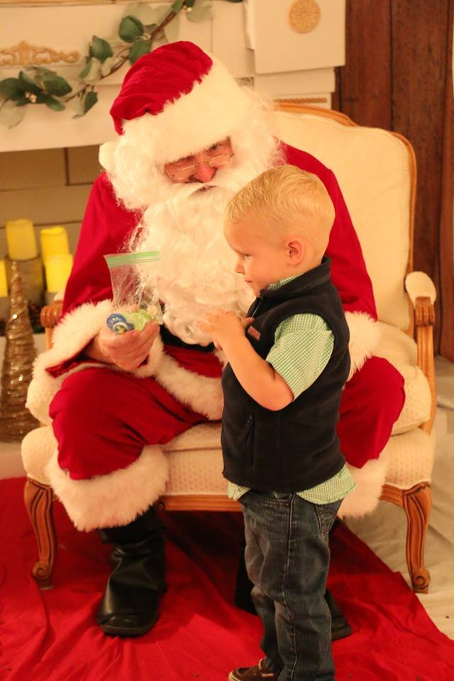 Talon Drew of Bay Minette gives Santa a bag of pacifiers. It is time for Talon to give them up, and who better to give them to than Santa?