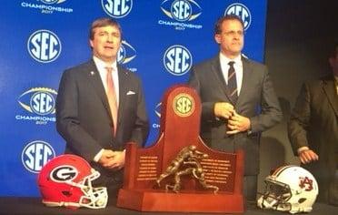 Auburn coach Gus Malzahn and Georgia Coach Kirby Smart pose with the SEC Championship trophy (Bri MacNaught/FOX10 News)