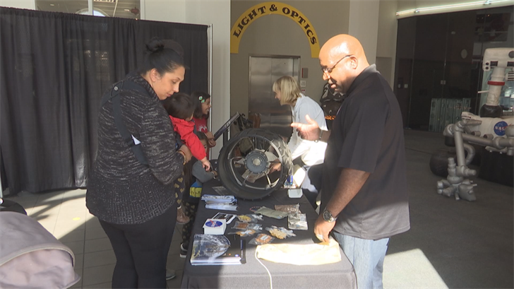 Dr. Kirsten Siebach and Darryl Gaines meet with visitors at the Exploreum (FOX10 News)