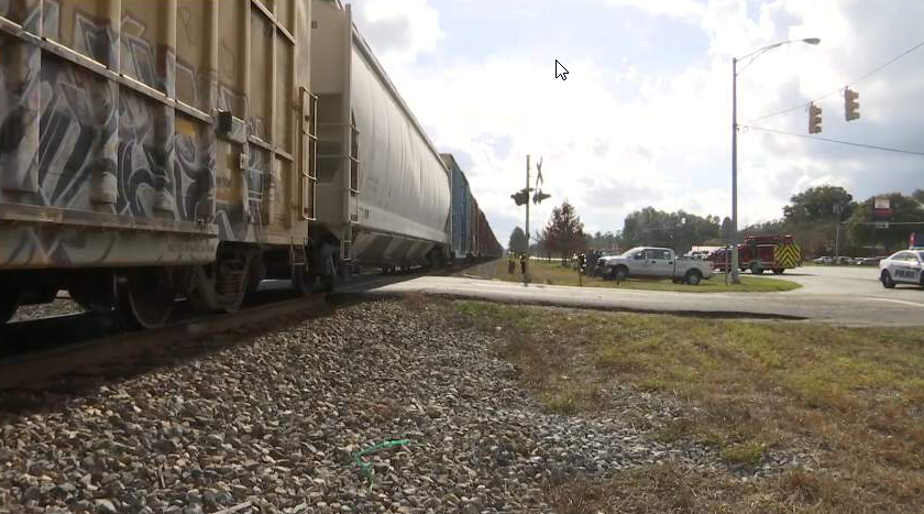 Rescue units are on the scene of an accident involving a train and a vehicle in Satsuma. Photo: FOX10 News