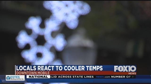 Locals react to cooler temperatures in downtown Mobile. Source: FOX 10 News