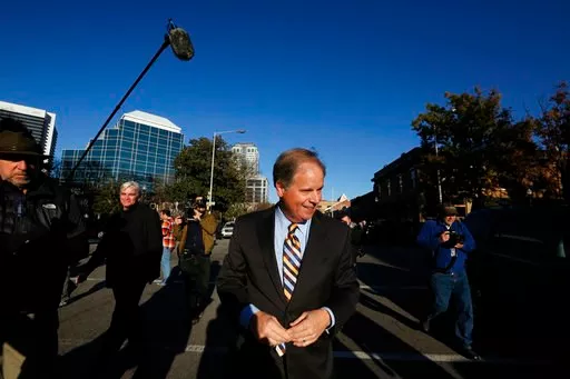 (AP Photo/Brynn Anderson). Democratic senatorial candidate Doug Jones, leaves after speaking at a campaign rally Sunday, Dec. 10, 2017, in Birmingham, Ala.