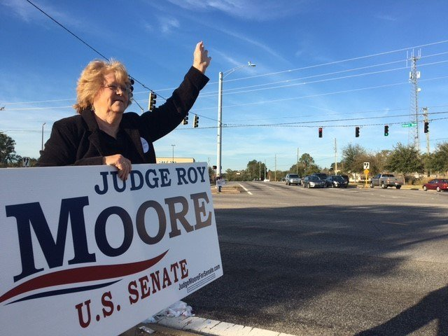 Moore supporters line Airport Boulevard the day before Election Day. Photo: FOX10 News Reporter Alexa Knowles.