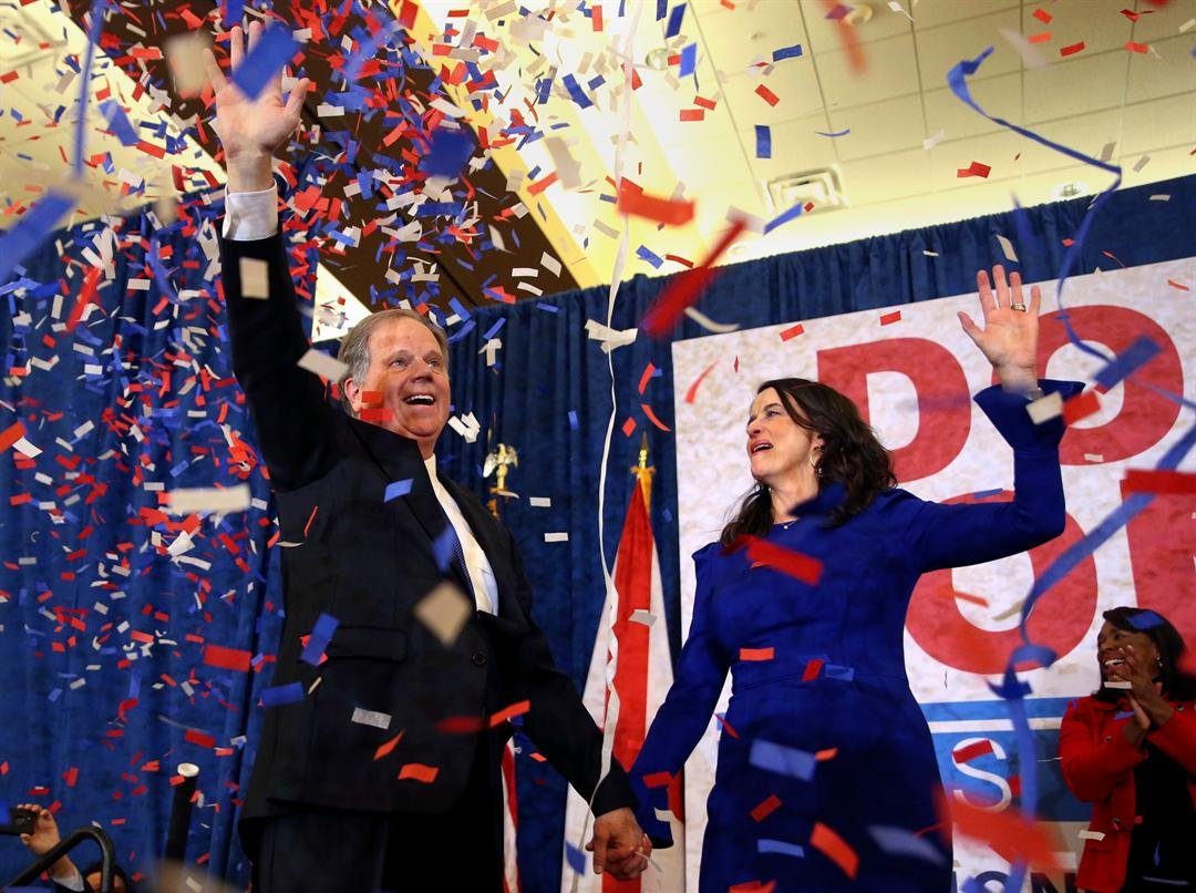 Senator-elect Doug Jones and his wife Louise wave to supporters after defeating Roy Moore (AP Photo/John Bazemore)