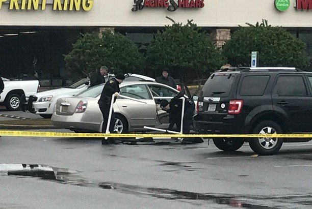 Police are on pictured on the scene of a reported shooting at a shopping center in Mobile. (Photo: Elizabeth Rodil, FOX10 News)