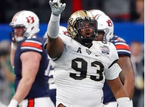 (AP Photo/John Bazemore). Central Florida defensive lineman Tony Guerad (93) celebrates a play against Auburn during the first half of the Peach Bowl NCAA college football game, Monday, Jan. 1, 2018, in Atlanta.