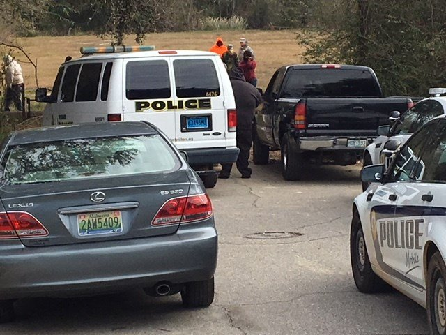 Mobile Police have confirmed the discovery of the body of a man, unidentified at this point, alongside a creek in a clearing near Moton and Whitney street in the Toulminville area. Photo: Steve Alexander, FOX10 News.