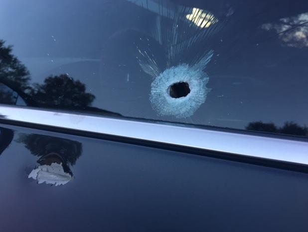 Female driver's vehicle shot 9 times