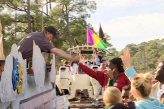 FOX10 News anchor Bob Grip rides in Dauphin Island People's Parade. (FOX10 News)