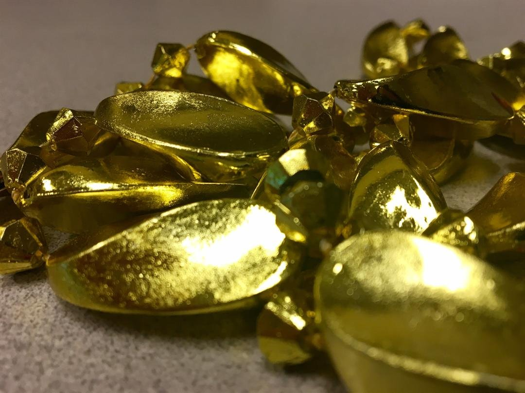 These gold metallic Mardi Gras beads, purchased this year in Mobile, were found to have a dangerously high level of lead on the surface of the beads. (Credit: Kati Weis, WALA FOX10 News)