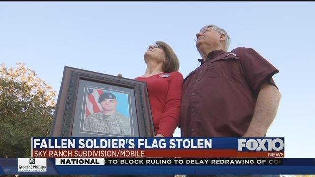 Flag raised in honor of fallen solder Army Specialist Michael Cote' stolen from Sky Ranch subdivision entrance. Source: FOX 10 News