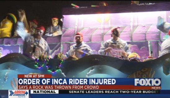 A member of the Order of Inca riding a float Friday, February 2, suffered a concussion and other medical problems after he was struck by a rock thrown by someone in the crowd.