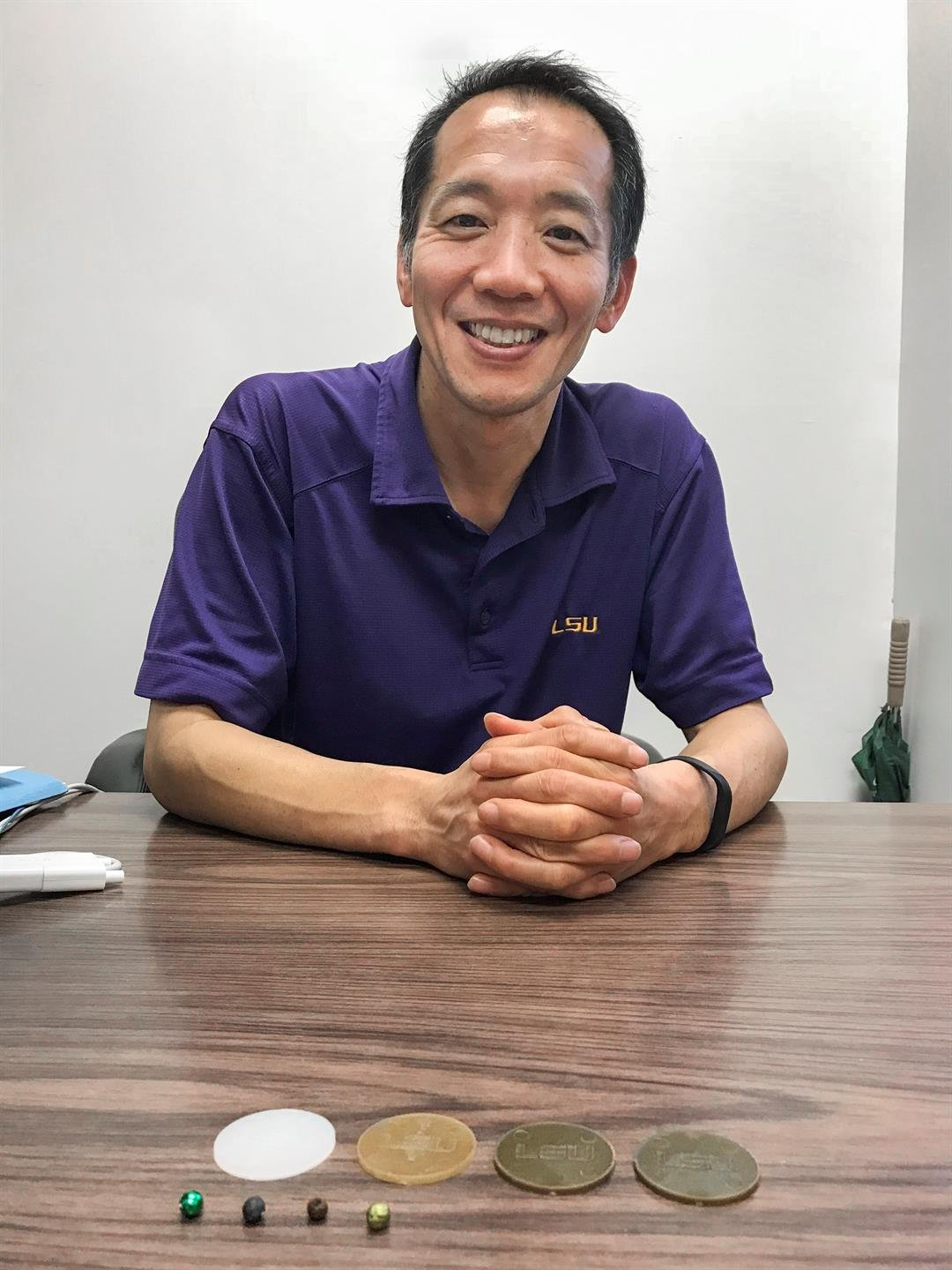 Dr. Naohiro Kato, with his biodegradable beads and doubloons. Source: LSU