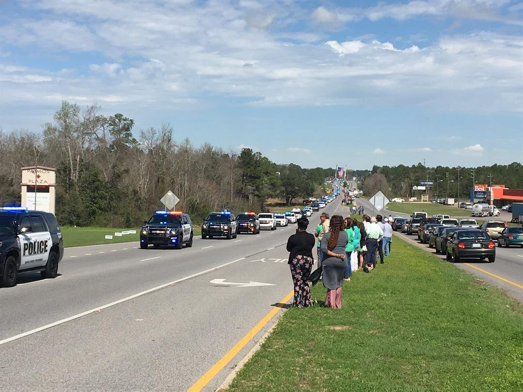 Hundreds line the street of Highway 90 to pay final respects to fallen MPD Officer Justin Billa (Photo: Asha Staples, Reporter)
