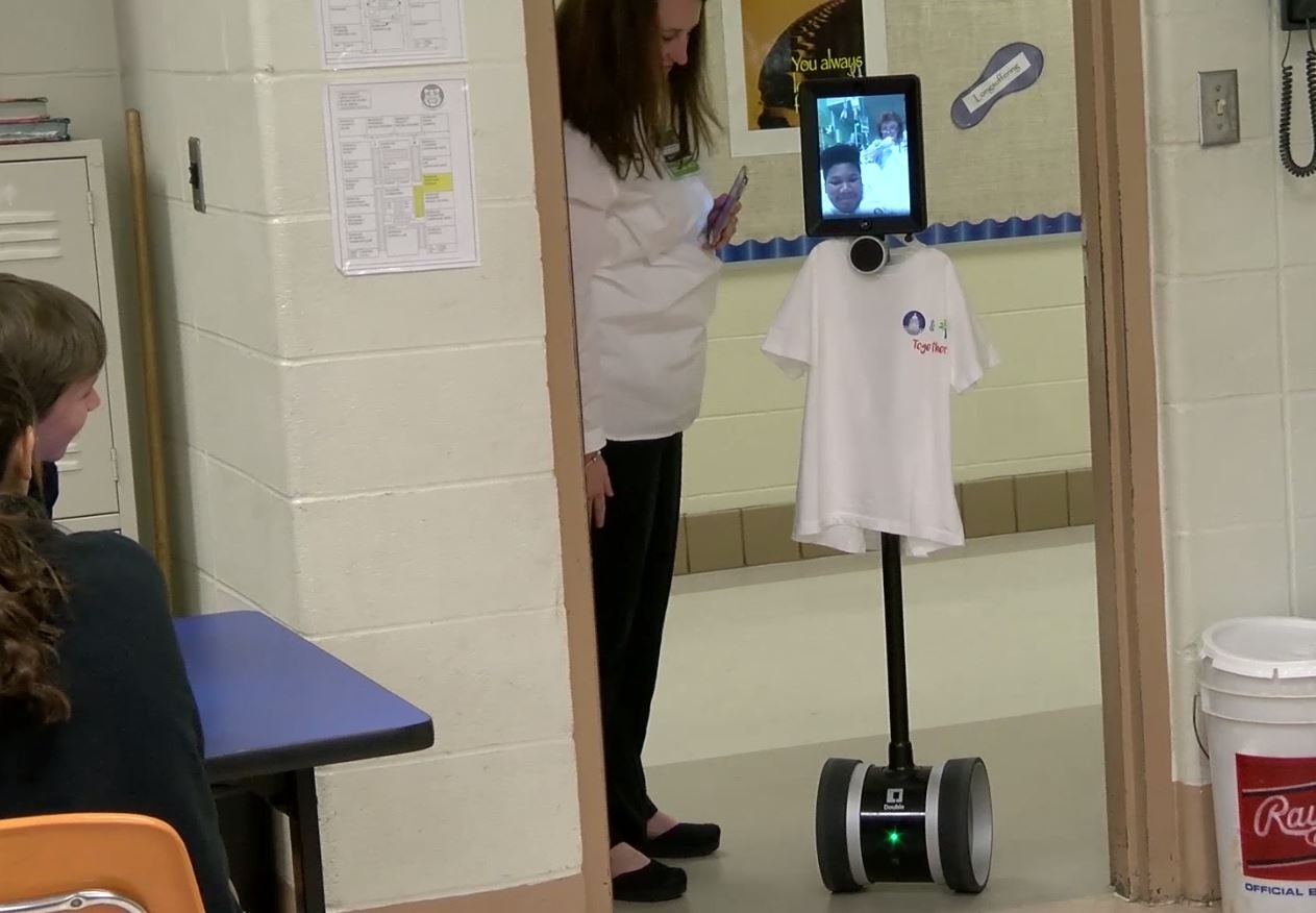 Causey Middle School sixth grader Alton Edwards attends class via an interactive robot. (Mobile County Public Schools)