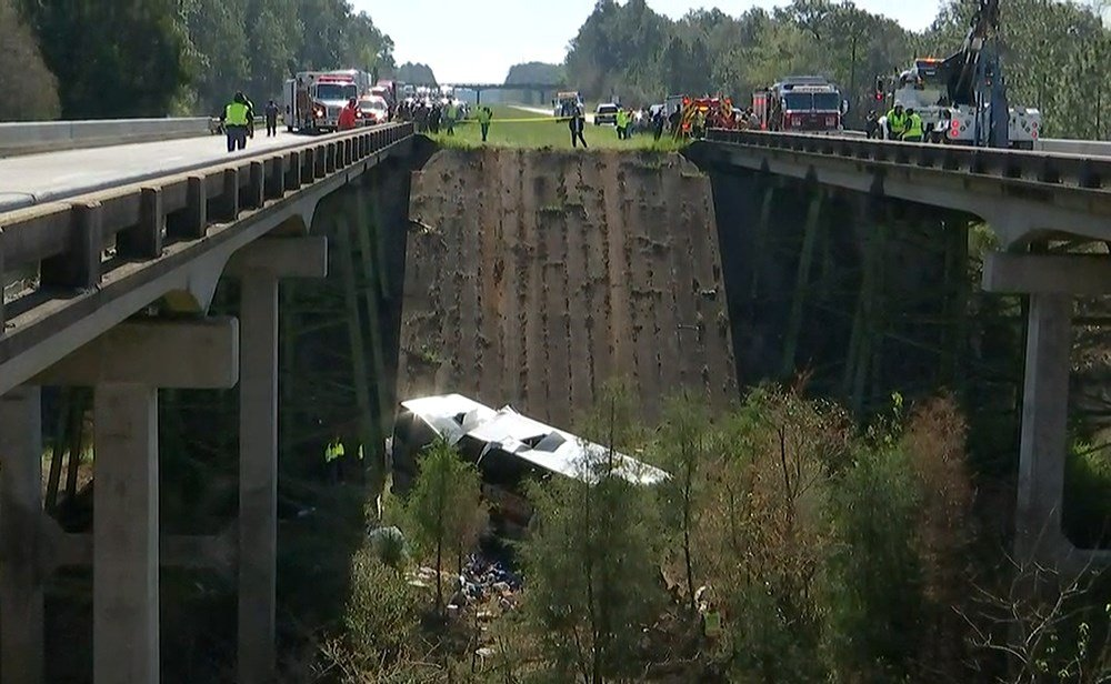 A First Class Tours charter bus carrying high school band students from Channelview, Texas, lies in a ravine where it crashed off I-10 in Baldwin County, Alabama. (FOX10 News)
