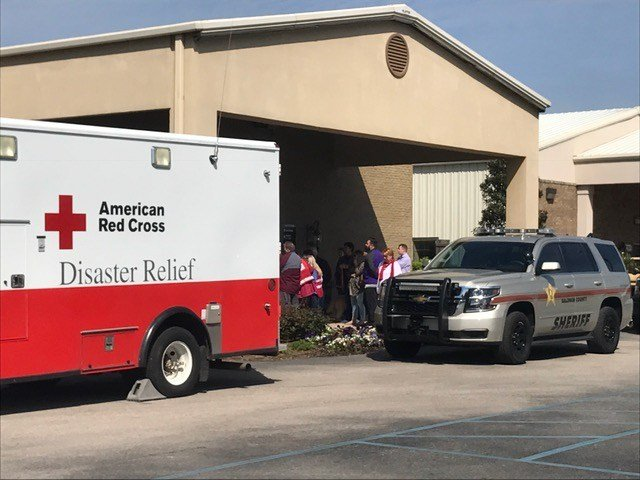 According to officials uninjured passengers will be reunited with family members and Channelview school officials at Coastal Church on County Road 64 in Daphne. Photo: Elizabeth Rodil, FOX10 News.