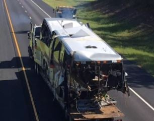 The wreckage of the charter bus that plunged down a ravine in Baldwin County, Alabama, is removed from the scene. (FOX10 News)