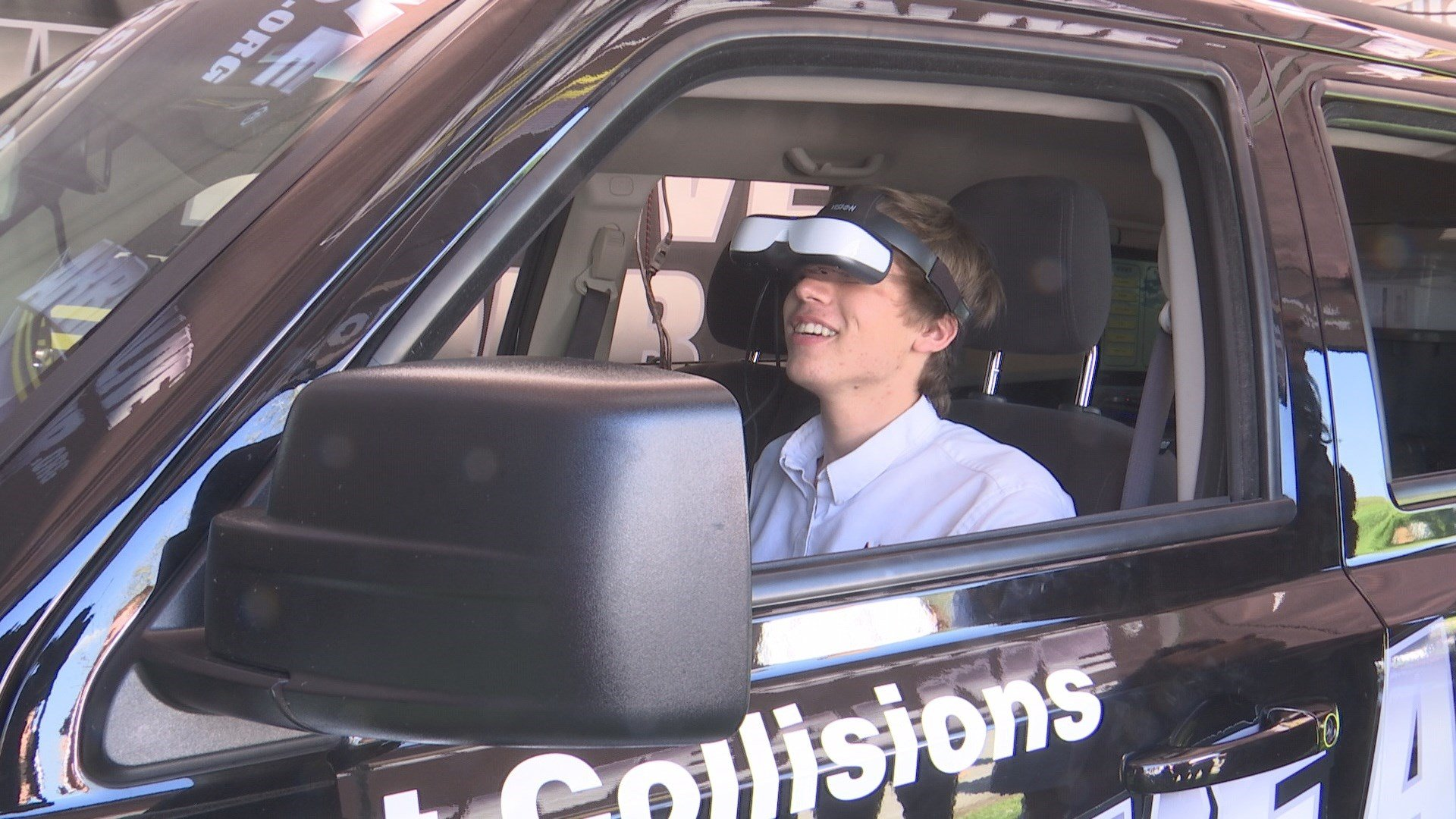 Students experience virtual reality driving.