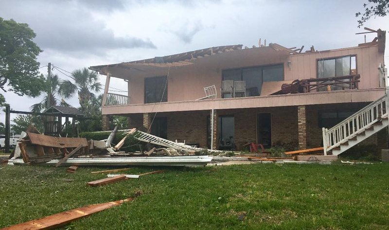 Tornado forms over water and moves onshore in fort walton beach home damaged by tornado in fort walton beach photo okaloosa county sheriffs office solutioingenieria Image collections