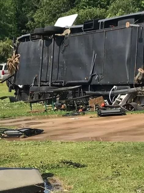 Overturned travel trailer at Anchors Aweigh RV Resort in Foley