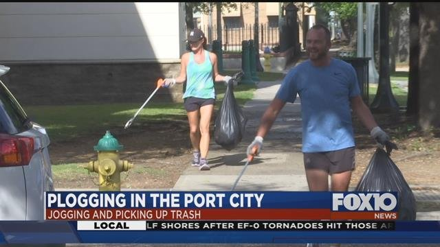 Joggers picking up trash in downtown Mobile. Source: FOX 10 News