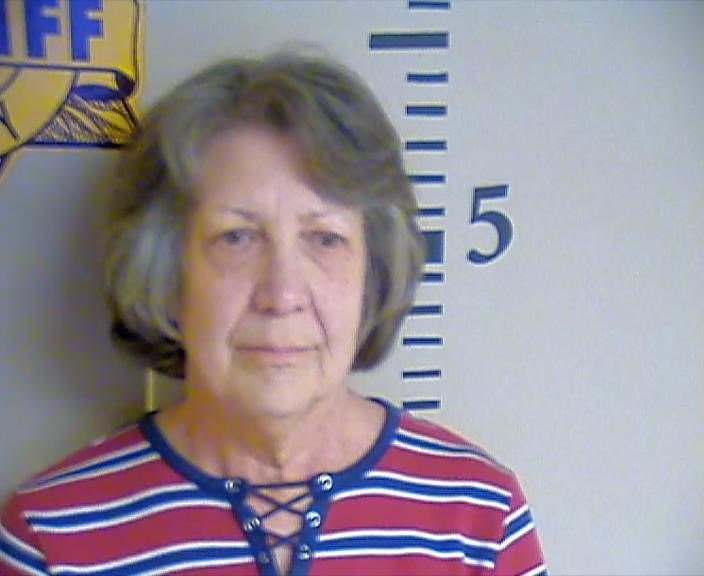 Former Washington County Revenue Commissioner Laura LeeTaylor has been charged with four counts of possession of a forged instrument.