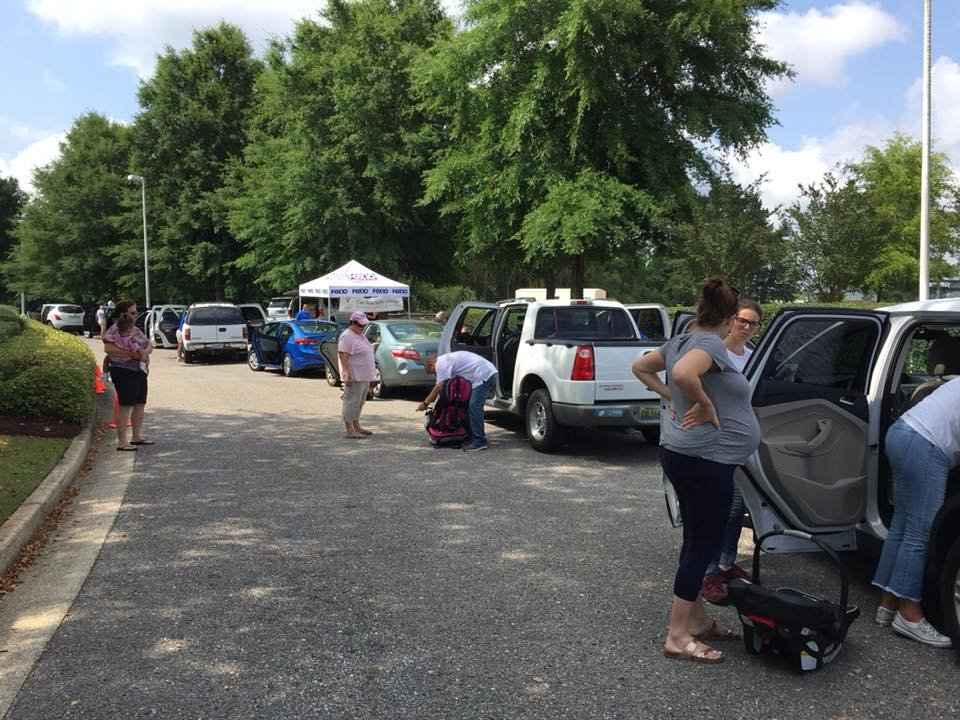 Dozens of parents showed up for this year's car seat safety event (Photo: Sarah Wall, Morning News Anchor)