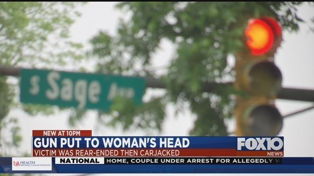Woman carjacked at gunpoint after fender-bender. Source: FOX 10 News