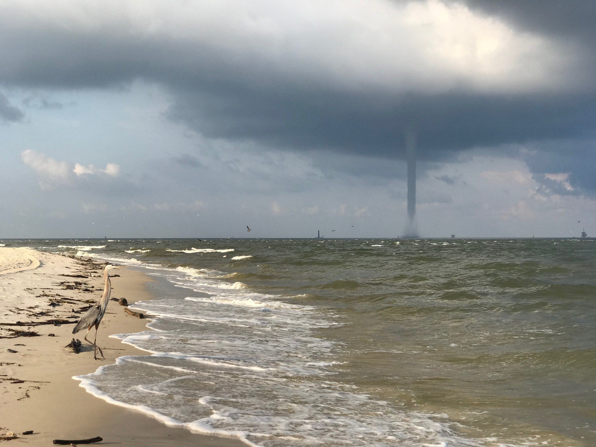 FOX10 Newsviewer Sam Sumlin provides these images of a waterspout seen from the beach at Fort Morgan.