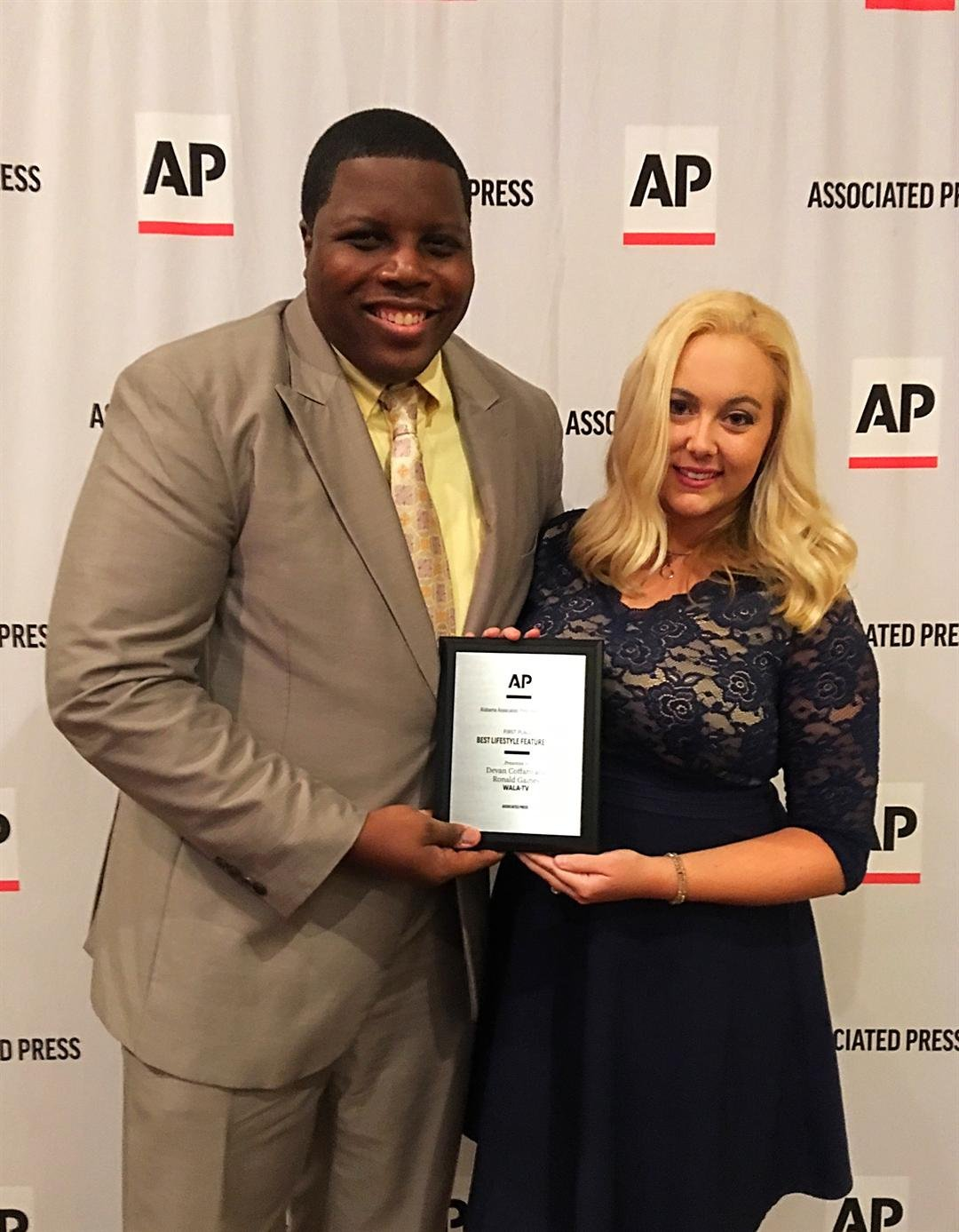 FOX10 News reporter Devan Coffaro and photographer Ronald Gaines pose with an AP Award. (FOX10 News)
