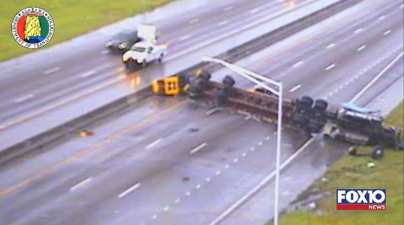 The 18-wheeler was overturned in the southbound lanes of I-65 just north of Airport Boulevard