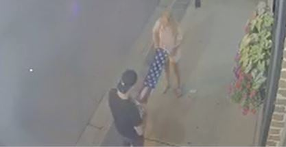 This couple folded an American flag that was trampled minutes earlier. Photo: Margaret Dopson.