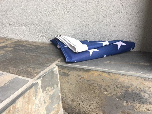 Margaret Dopson says her American flag was folded and left like this on her doorstep Sunday morning. Photo: FOX10 News Reporter Alexa Knowles.